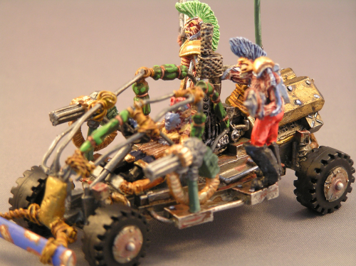 Cage car with 3 Mohawk riders