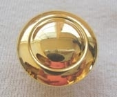 Bright gold metallic effect button