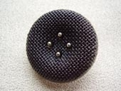Silver metallic effect button