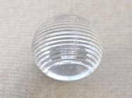 Domed clear shanked button.